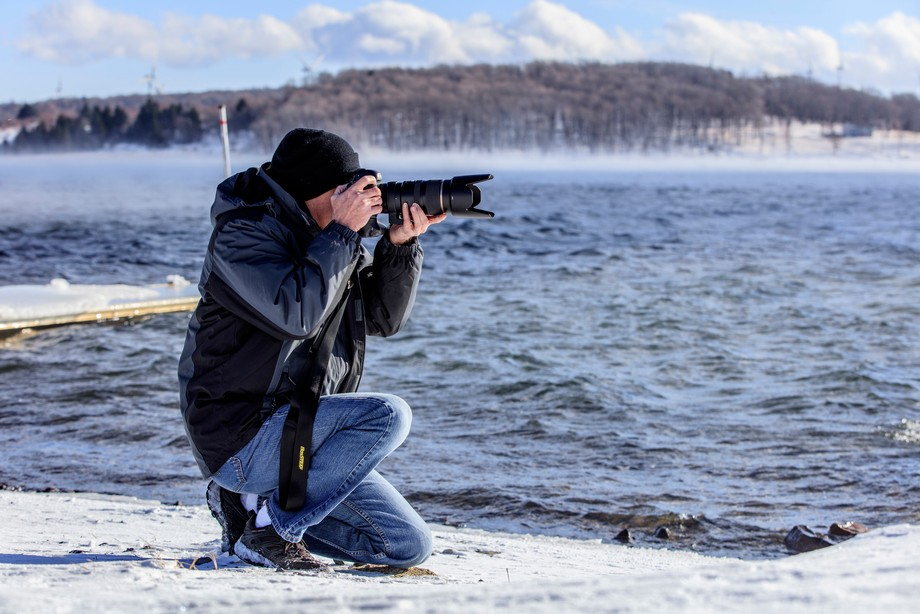 My friend and fellow photographer, Scott, on the shore of Mount Storm Lake photographing the scen...