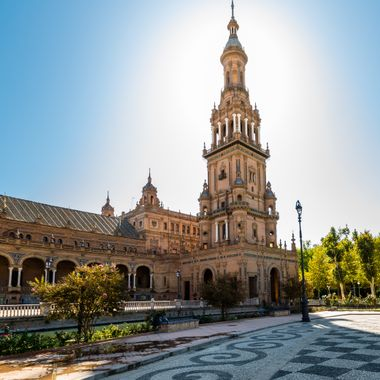 a sun lit shot of one of the towers at Plaza De Espana in Seville, Spain