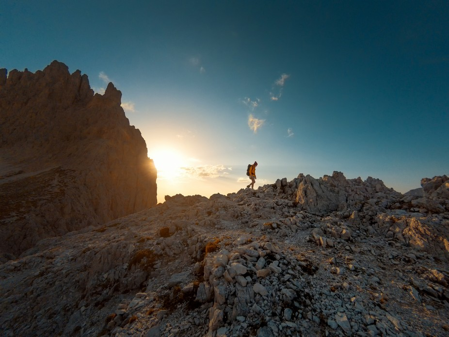 Hiking at sunset in the Dolomites