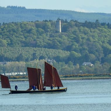 Such Fun in Findhorn Bay with Nelson's Tower in the background.