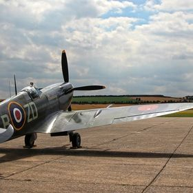 Two aircraft that almost 80 years ago had tried to disable each other now share the same taxiway under a peaceful sky. Spitfire with Me 109 taxii...
