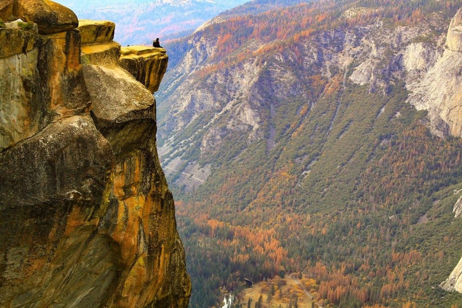 Breathtaking view of Yosemite Valley during fall. Easy 1 mile hike by Glacier Point. A person enj...