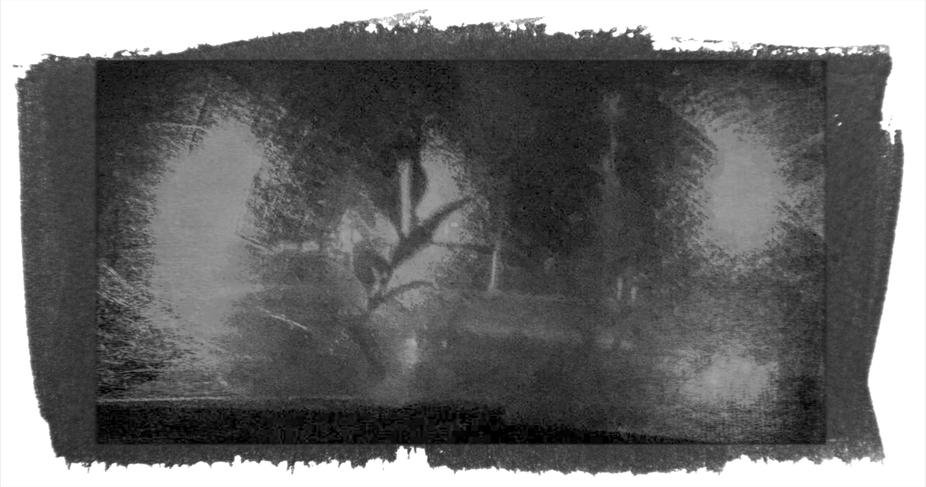 Through the rainy windshield.