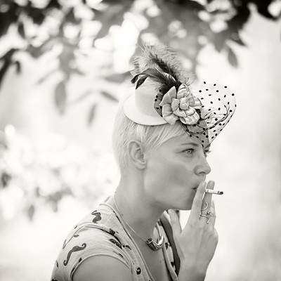 a lady with a fancy hat and cigarette...