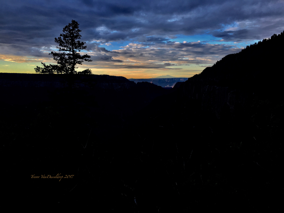 It was a cool early morning Sunrise, after a long night of storms, looking South through the Gran...