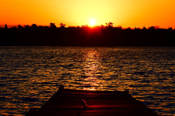 Beautiful golden sunrise over the back dock on Rainy Lake!
