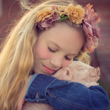 Alberten Girl loves piggies.
