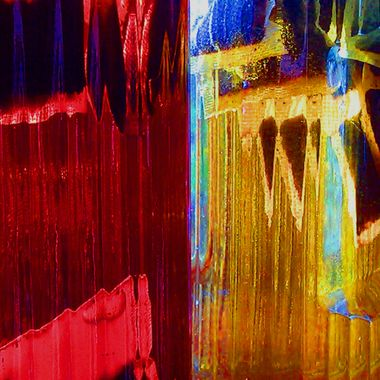 Red and Gold Light Refraction Through Colored Water