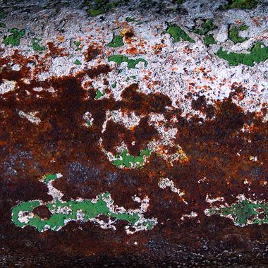Rust With Flaking Green and White Paint