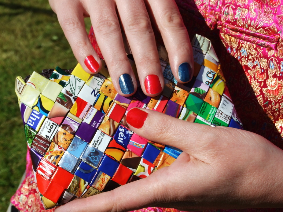 The clutch bag was made in a village in Borneo out of sweet wrappers