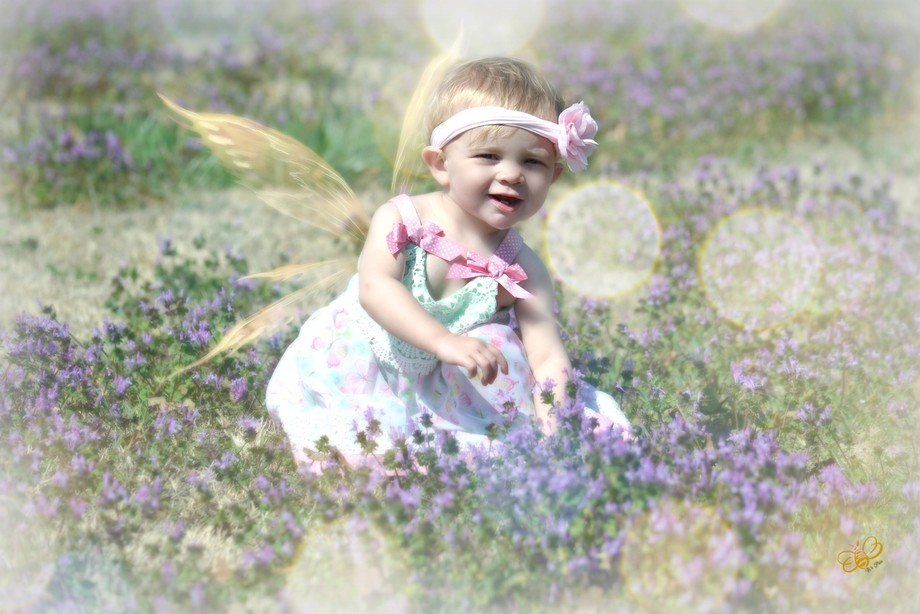 Granddaughter playing in flowers