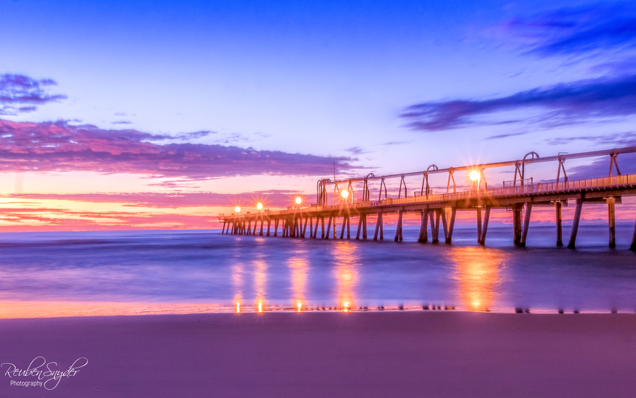 Sunrise over the Spit jetty