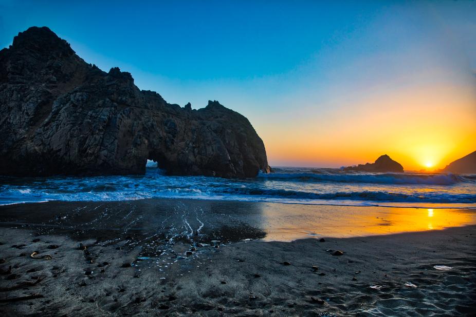 Beautiful sunset in Big Sur.  Enjoyed watching the waves crash through the rock keyhole!