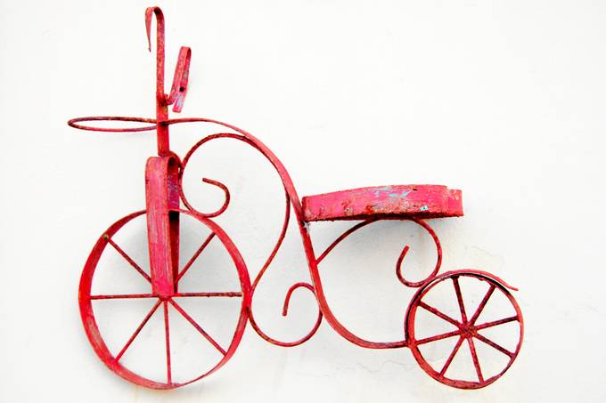 Red Bicycle ornament on wall