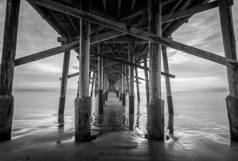 Long exposure of a southern California pier in black and white