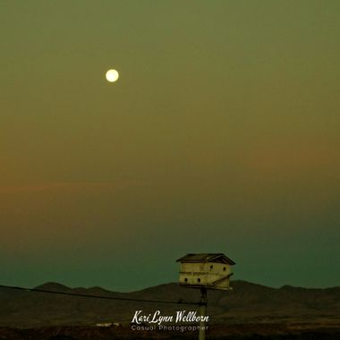 smokey morning moon setting