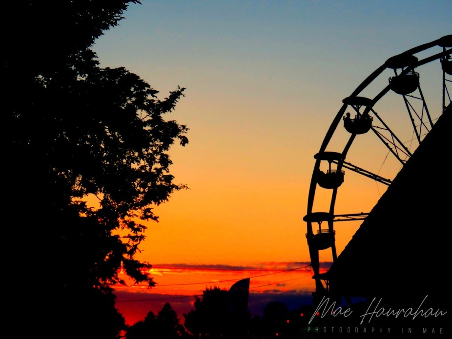 Ferris wheel at sunset at the Brooklyn Fair in Brooklyn, CT, the longest running agricultural fai...