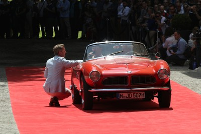 Red roadster on red carpet