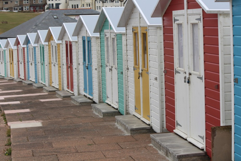 Experimental use of light...and colour.. Beach huts at Croyd Bay.