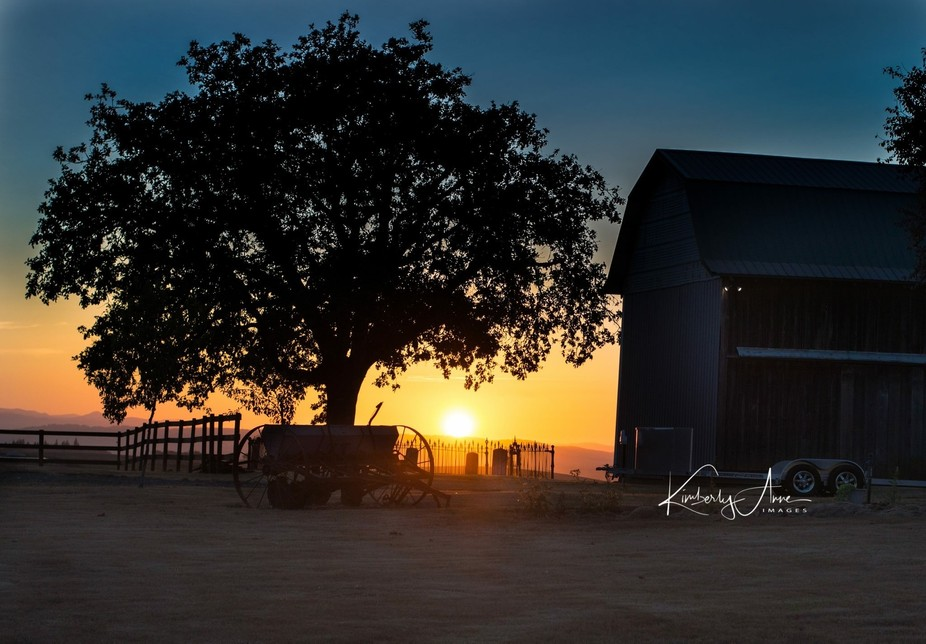Old farm at sunset