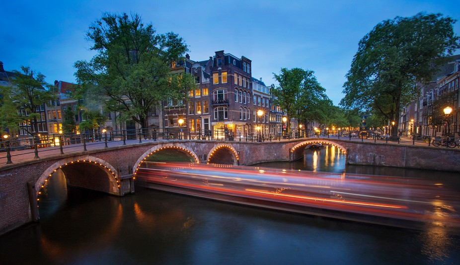 Long exposure of a boat in the canals of Amsterdam, Netherlands.