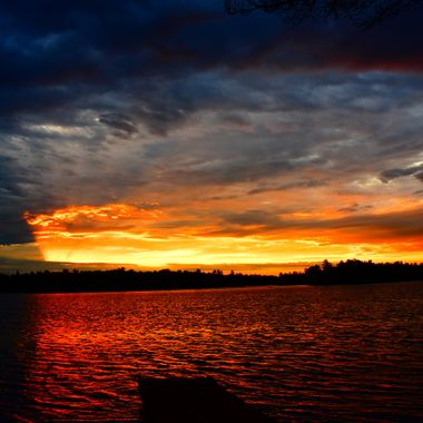 Gorgeous morning sunrise over the back dock where the cloud bank drew a vail on the left part of the photo  D3400 Nikon 18- 55 lens vivid