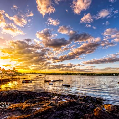 Sunset at New Castle NH looking toward Portsmouth NH, the sun was setting with these great clouds