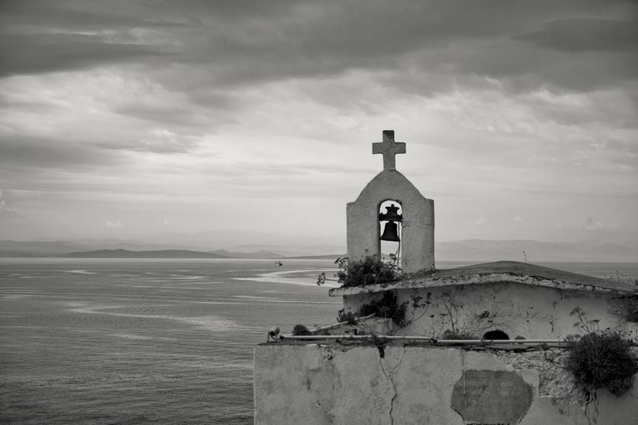 Chapelle de Saint-Roch in Bonifacio, Corsica with the coastline of Sardinia. Nature slowly takes ...