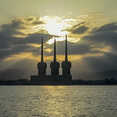 Taken from a catamaran. It was an irresistible image. The camera was a small Canon compact. The three towers are a power station.