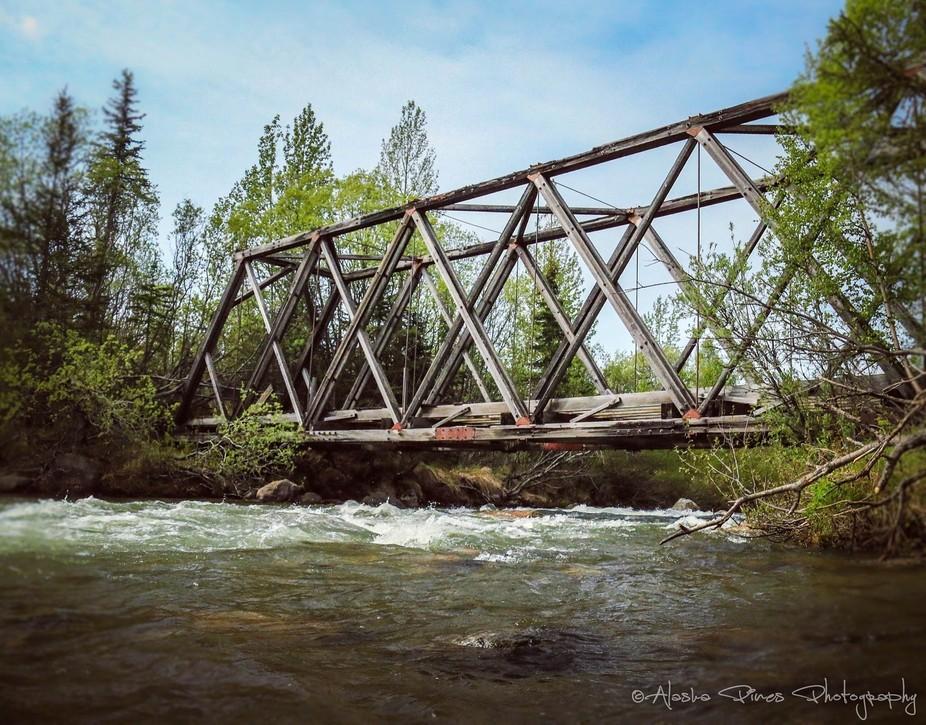 This is an old wooden bridge crossing the Willow Creek, near Hatcher's Pass, Alaska