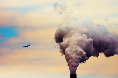 Airplane flies in a cloud of smoke