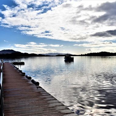 Lovely day lovely reflective skies from the Jetty Loch Lomond
