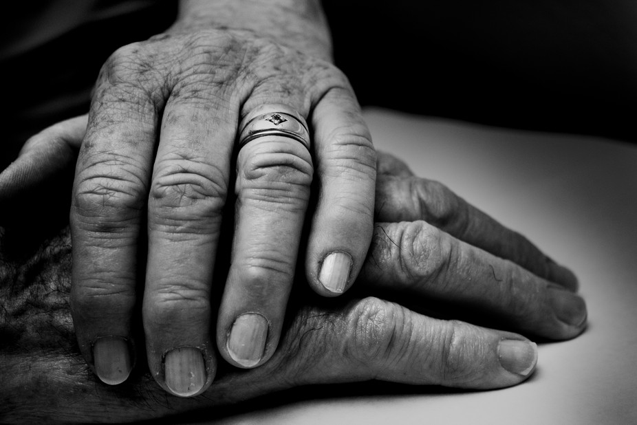 A photo of my grandma's hand resting on my grandad's; they have been married fo...