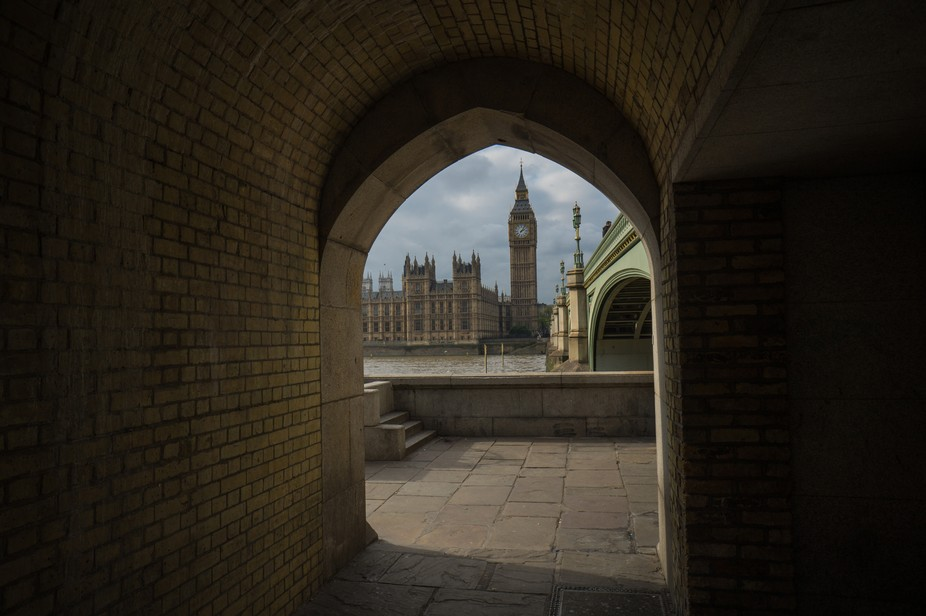 The Houses of Parliament through an archway on the South Bank. (Colour version)