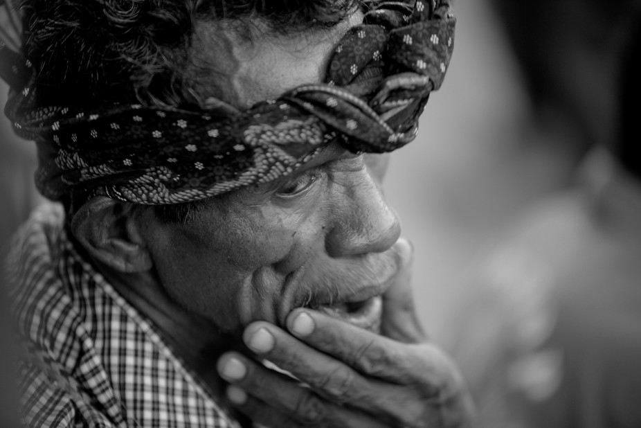 A man from Timor with a headband made of batik cloth. It is a tradition of hereditary, Destar use...