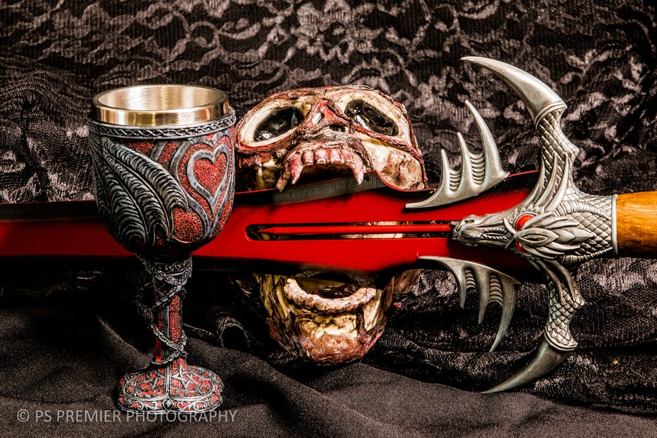 These are the tools of Kellee the Vampyre. Her blood sword. Her Blood Goblet and the skull of her...