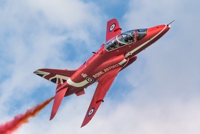 Synchro Leader Red 6 Si Taylor  Trailing Red Smoke in a lovely Lincolnshire sky UK