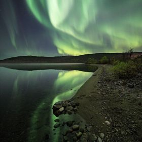 Northern lights over the lake Naljarvi. Kola peninsula.