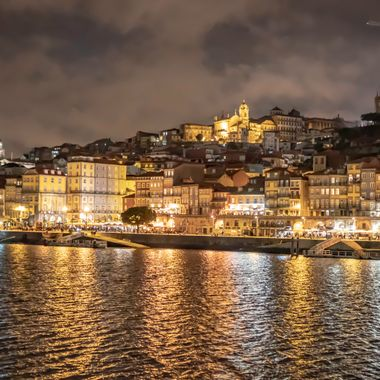 Night shot of the Douro River in Porto Portugal.