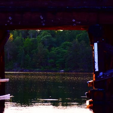 The only boat opening thru an old wooden Railroad bridge at sunset!  Nikon D340070-300 lens