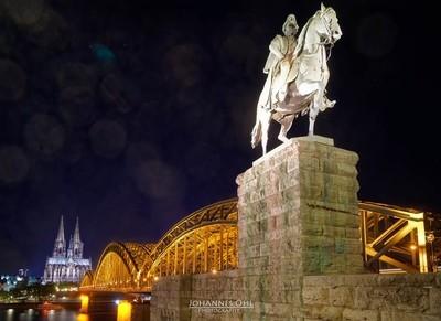 Hohenzollern Bridge with equestrian statue of the german emperor Wilhelm I.
