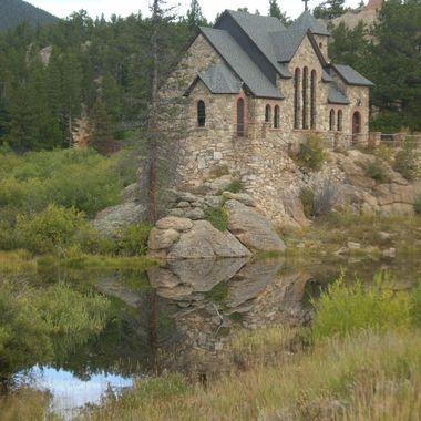 The Chapel is at the base of Mt. Meeker in Allensark, Colorado. It is located on the grounds of  the St. Malo retreat, conference center.
