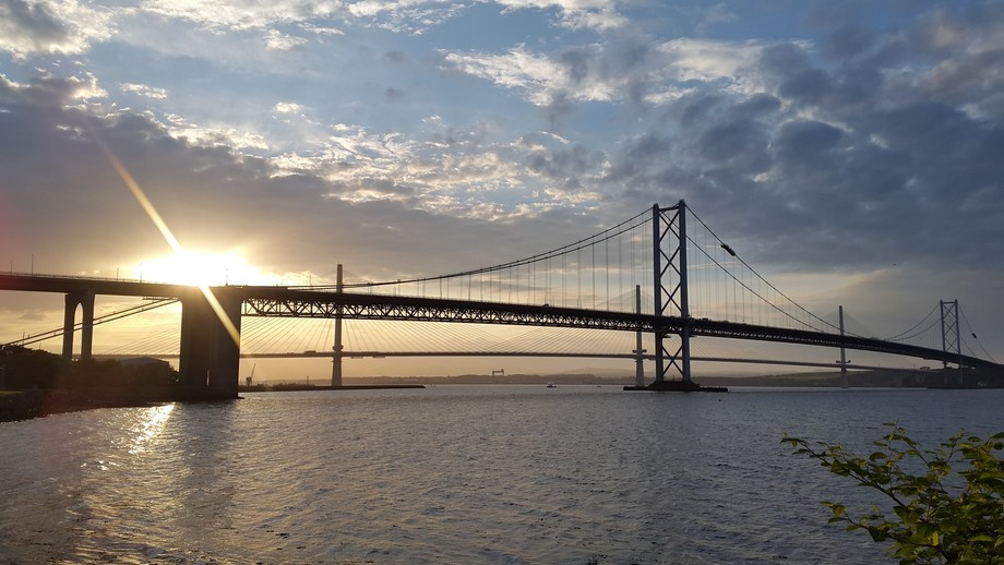 Forth Road Bridge and the Queensferry Crossing at sunset