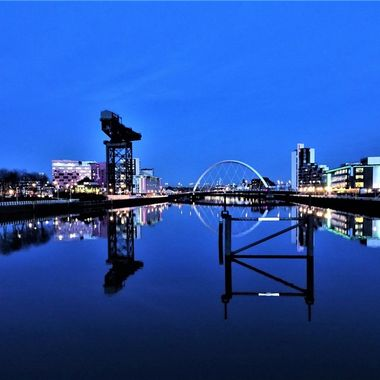 Lovely Clear blue night in Glasgow view from the bridge .