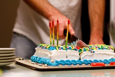 Man cutting birthday cake