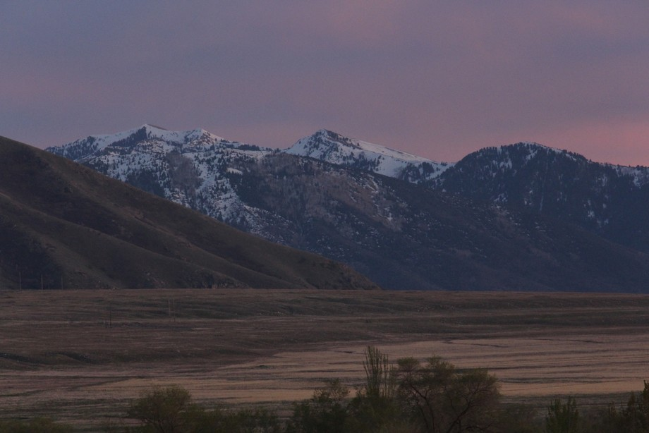 Taken in Tooele, Utah. April 25, 2018.  Snow caps and pink sky..a lovely sight.
