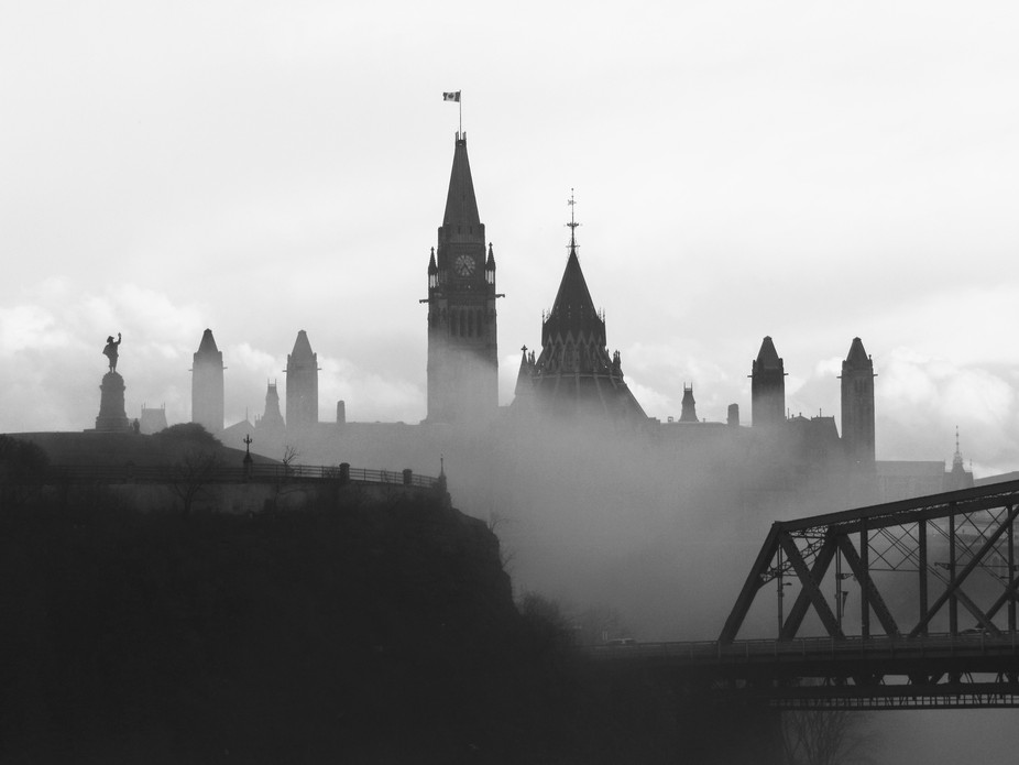 View from Ottawa River Cruise on a foggy evening in May.  Ottawa, Canada. Parliament Hill.