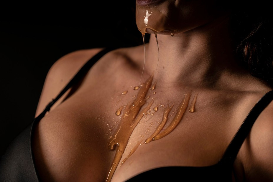 Model with Honey dripping down her skin.