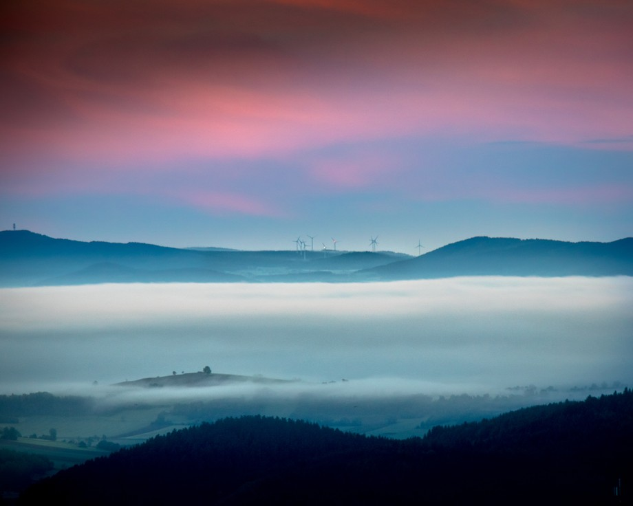 The land of the Auvergne in France, covered in clouds on an early morning in June