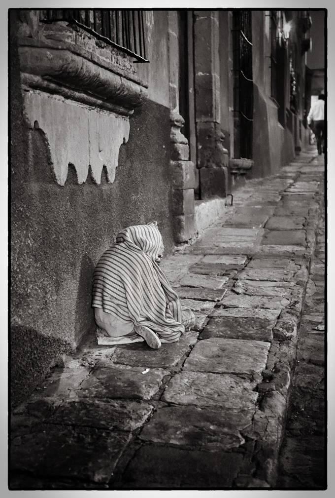 Old lady, begging on the street of San Miguel De Allende, Mexico